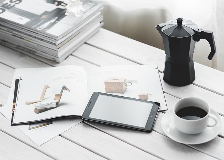 coffee tablet and magazines
